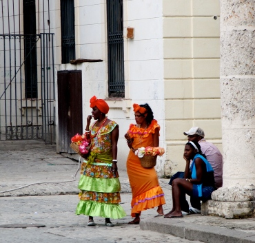 Habaneras pose in the Plaza De La Cathedral in Cuban costumes