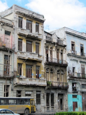 Although the facades are peeling and faded, I still see them as they once looked: pink, yellow and blue