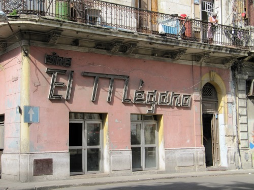 The El Megano Cinema is a shadow of its former self:  shabby and dark, it plays second-run films, sells cheap alcohol and attracts shady clientele who are as colourful as the pink and yellow facade was 40 years ago.