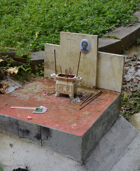 A Christian Woman's grave. Her memory is honoured with joss sticks